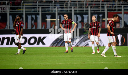 Milan, Italy. 8th Mar, 2018. AC Milan's players react after losing a Europa League round of 16 first leg soccer - Stock Photo