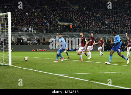 Milan, Italy. 8th Mar, 2018. Arsenal's Aaron Ramsey (1st L) scores a goal during a Europa League round of 16 first - Stock Photo