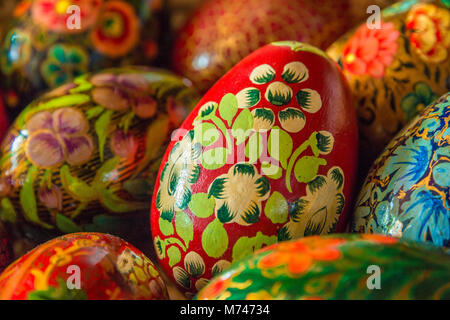 Easter decoration: Close-up of a red painted egg with floral pattern. - Stock Photo