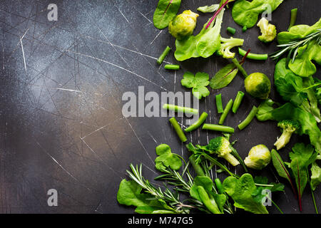 Food background. Various summer fresh herbs on a dark stone background. Diet, concept of vegetarian food. Copy space. - Stock Photo