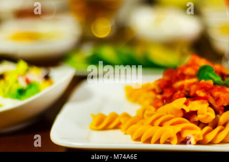 tasty dish with pasta, meat and sauce, Italian dish, fast and simple dish, lunch or dinner - Stock Photo