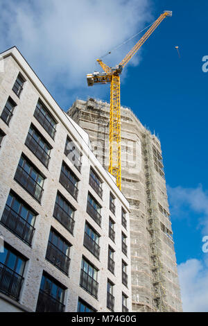 tall modern and contemporary office buildings under construction in the centre of London with scaffolding built - Stock Photo