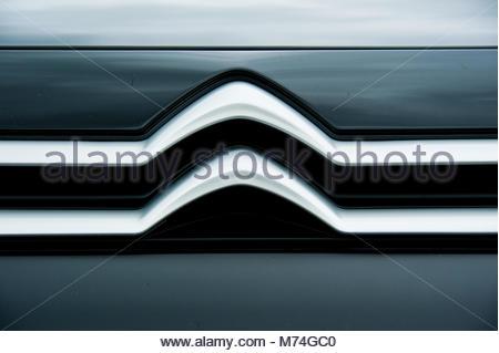 Citroen logo & sign on the front grill of a black Citroen Berlingo combo van, England UK - Stock Photo