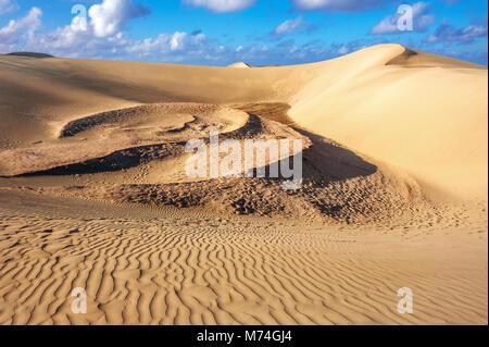 Sand dunes in famous natural Maspalomas beach. Gran Canaria, Canary islands, Spain - Stock Photo