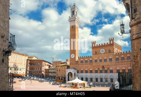 Building of town hall on Campo square (Piazza del Campo) and Torre del Mangia ( Mangia tower ) in Siena. Tuscany, - Stock Photo