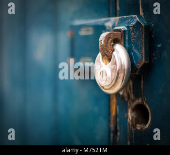 A picture close up of the detail of a padlock securing a garage building in Shrewsbury - Stock Photo