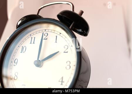 Daylight Savings Spring Forward sunday at 2:00 a.m. March 11. Sunlight in the background - Stock Photo