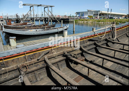 Collection of authentic historic boats from Scandinavia and full scale navigable reconstructions of Viking ships - Stock Photo