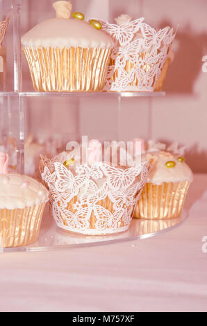 Cupcakes on a cake rack - Stock Photo