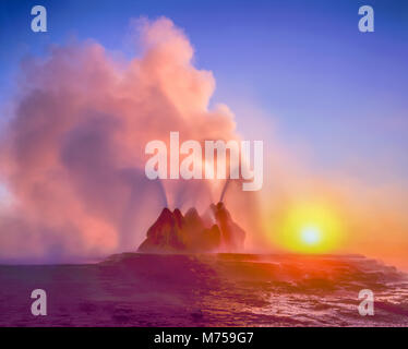 Fly Geyser at sunrise, Black Rock Desert, Nevada, Hot spring geyser on playa rim, colors from algae in hot spring - Stock Photo