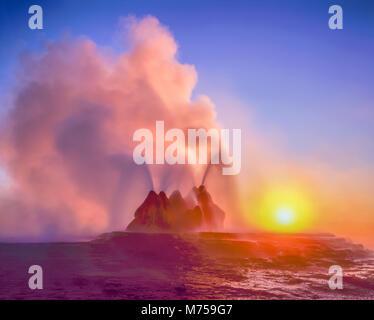 Fly Geyser at sunrise, Black Rock Desert, Nevada, Hot spring geyser on playa rim, colors from algae in hot spring - Stock Photo