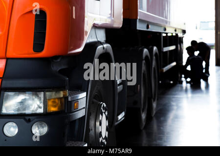 automobile mechanic checking truck in the garage, selective focus - Stock Photo