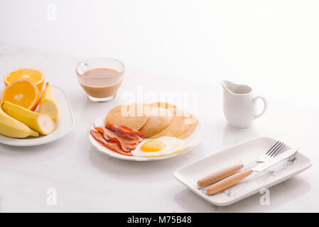Breakfast plate with pancakes, eggs, bacon and fruit. - Stock Photo