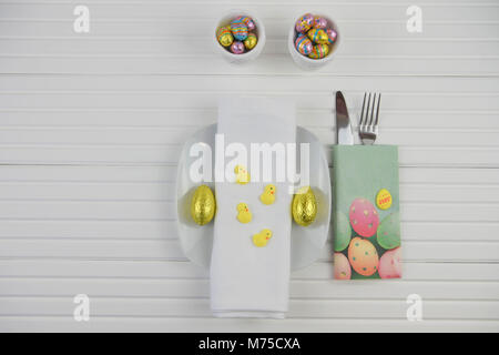 colorful Easter table place setting on white - Stock Photo