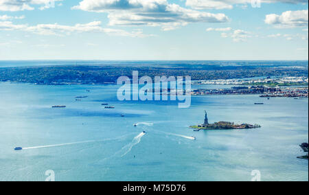 panoramic view of the Upper Bay in New York with Statue of Liberty and Staten Island in the distance - Stock Photo