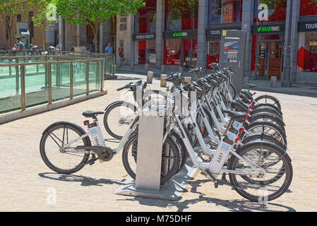 Madrid, Spain - June 05, 2017 : Square Plaza Ramales of Madrid in the downtown with bicycles in the parking, bike - Stock Photo