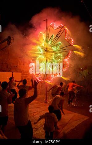 Firework celebrations at The Feast of the Sacred Heart of Jesus Festa. Fontana, Gozo, Malta - Stock Photo