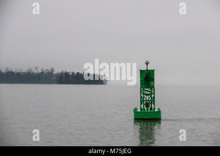 A green bell buoy channel marker outside of Norwalk Harbor in Connecticut USA - Stock Photo