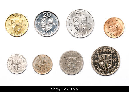 Ghanaian coins on a white background - Stock Photo