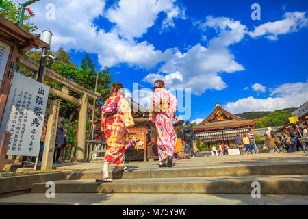 Kyoto, Japan - April 24, 2017: Japanese women in kimono visit Yasaka Shrine in spring season. Gion Shrine is one - Stock Photo