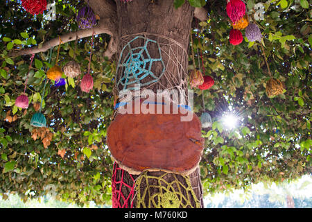 rendering of signboard on colorful tree - Stock Photo