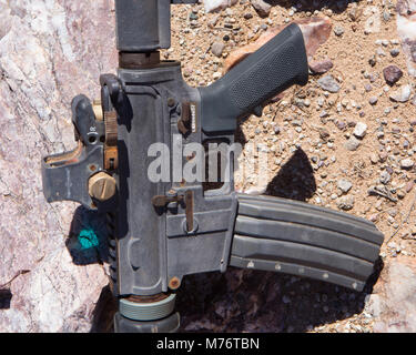 An AR 15 found in the desert. A smuggler's weapon. - Stock Photo