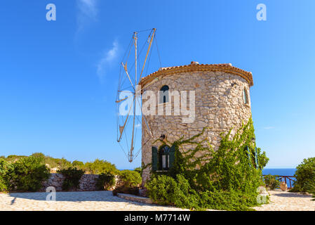 Traditional Greek old windmill on Skinari cape. Zakynthos island, Greece - Stock Photo