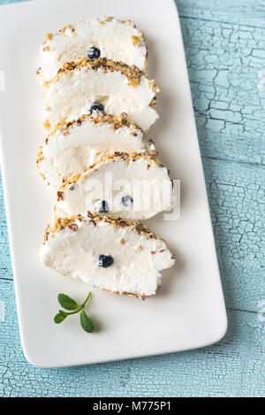 Sliced merengue roll with nuts - Stock Photo