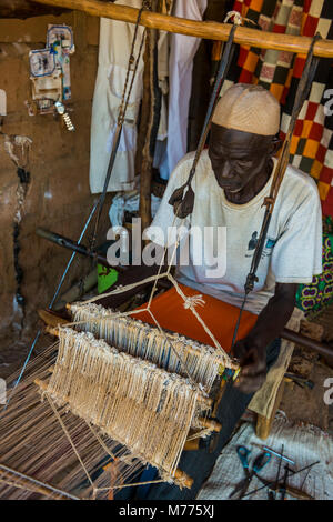 Man weaving on a traditional loom in the National Museum, Niamey, Niger, Africa - Stock Photo