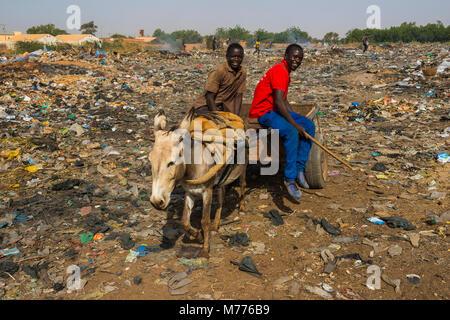Friendly boys on a public rubbishdump, Niamey, Niger, Africa - Stock Photo