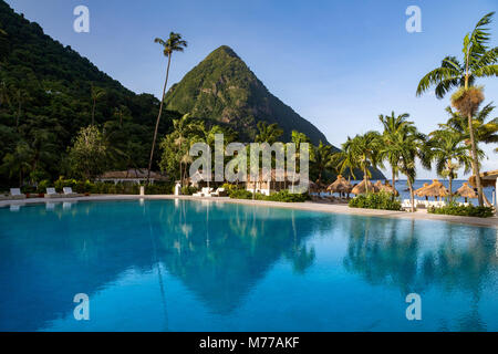 Gros Piton, UNESCO, and reflection in the swimming pool at Sugar Beach, St. Lucia, Windward Islands, West Indies, - Stock Photo