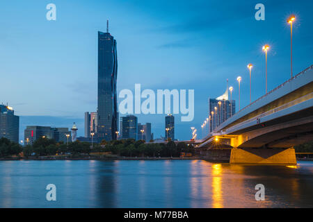 Donau City and DC building reflecting in New Danube River, Vienna, Austria, Europe - Stock Photo