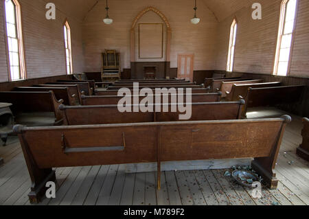 The interior of an abandoned Methodist Church in ghost town Bodie, in Bodie State Historic Park, CA USA - Stock Photo