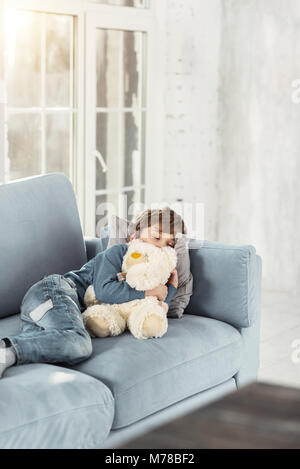 Lovely little boy sleeping with his toy Stock Photo