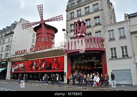 PARIS - 05/05/2016: The Moulin Rouge  in Paris, France. Moulin Rouge is a famous cabaret built in 1889, locating - Stock Photo