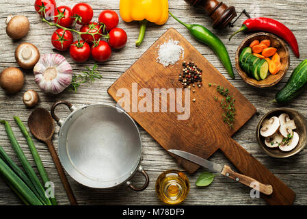 Fresh ingredients for cooking meal on wooden background place for text. Vegan food vegetarian and healthy cooking - Stock Photo