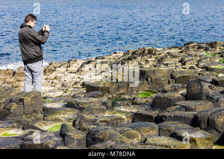 The Giant's Causeway, basalt columns from an ancient volcanic eruption in County Antrim on the north coast of Northern - Stock Photo