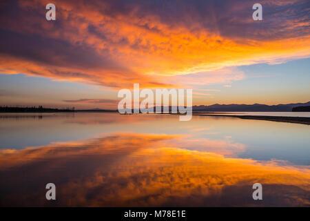 Sunrise on Yellowstone Lake (Flat Mountain Arm). - Stock Photo