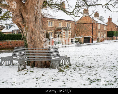 Snow covered village green at Aldborough near Boroughbridge North Yorkshire England - Stock Photo