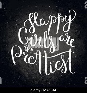 Happy girls are the prettiest. Hand written calligraphy quote motivation for life and happiness on blackboard. For - Stock Photo