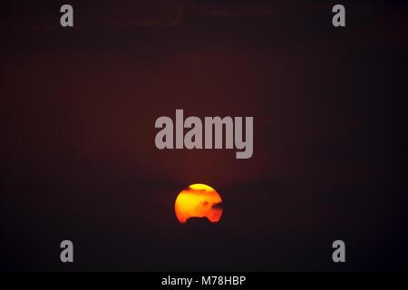 red sun rising bhopal - Stock Photo