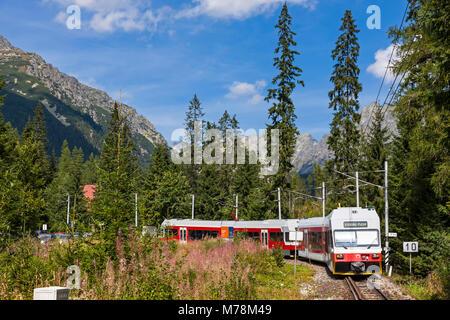 High Tatras, Slovakia - August 27, 2015: Tatra Electric Railways (TEZ-TER) train (also known as 'Tatra tram') arrives - Stock Photo