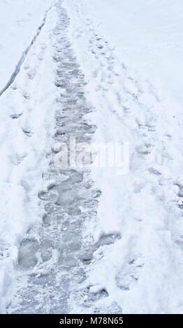 Footprints on the snow. Paris. France - Stock Photo