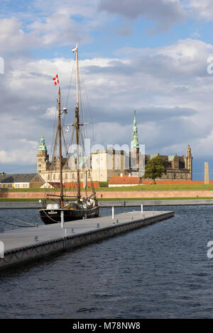 Tall ship in harbour with Kronborg Castle used as setting for Shakespeare's Hamlet, Helsingor, Zealand, Denmark, - Stock Photo