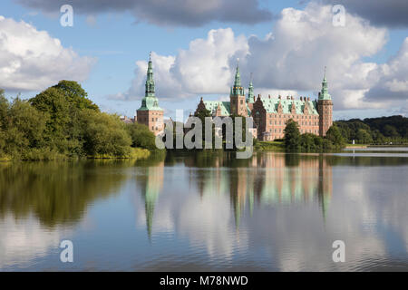 Frederiksborg Slot Castle built in the 17th century for King Christian 4th on Castle Lake, Hillerod, Zealand, Denmark, - Stock Photo
