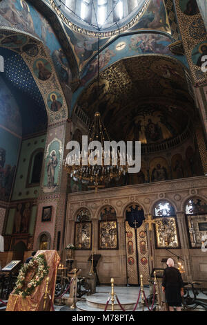 Worshipper at the altar of Sioni Cathedral, original built in 6th and 7th centuries, Old Town, Tbilisi, Georgia, - Stock Photo