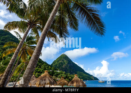 Gros Piton, with palm trees and thatched sun umbrellas, Sugar Beach, St. Lucia, Windward Islands, West Indies Caribbean, - Stock Photo