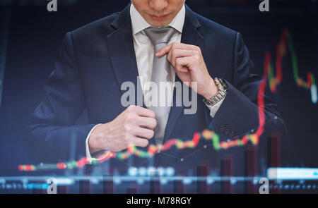 Double exposure, Businessman tying necktie with raising graph diagram background. Business growth and investment - Stock Photo