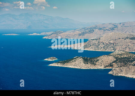 Aerial image of eastern Dodecanese Greek islands Koulondros, Seskli and Xisos in the Mediterranean Sea - Stock Photo