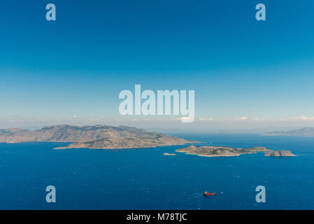 Aerial image of eastern Dodecanese Greek islands Koulondros, Seskli and Xisos in the Mediterranean Sea with Altera - Stock Photo
